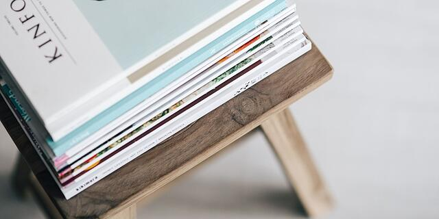 Bi fold brochures on wooden table