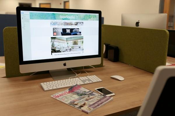 digital v print comparison of brochures on desk