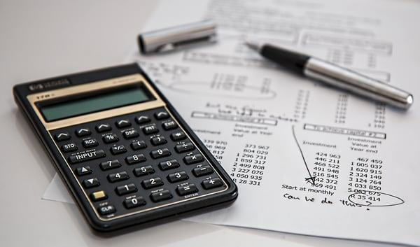 calculator, paper and pen