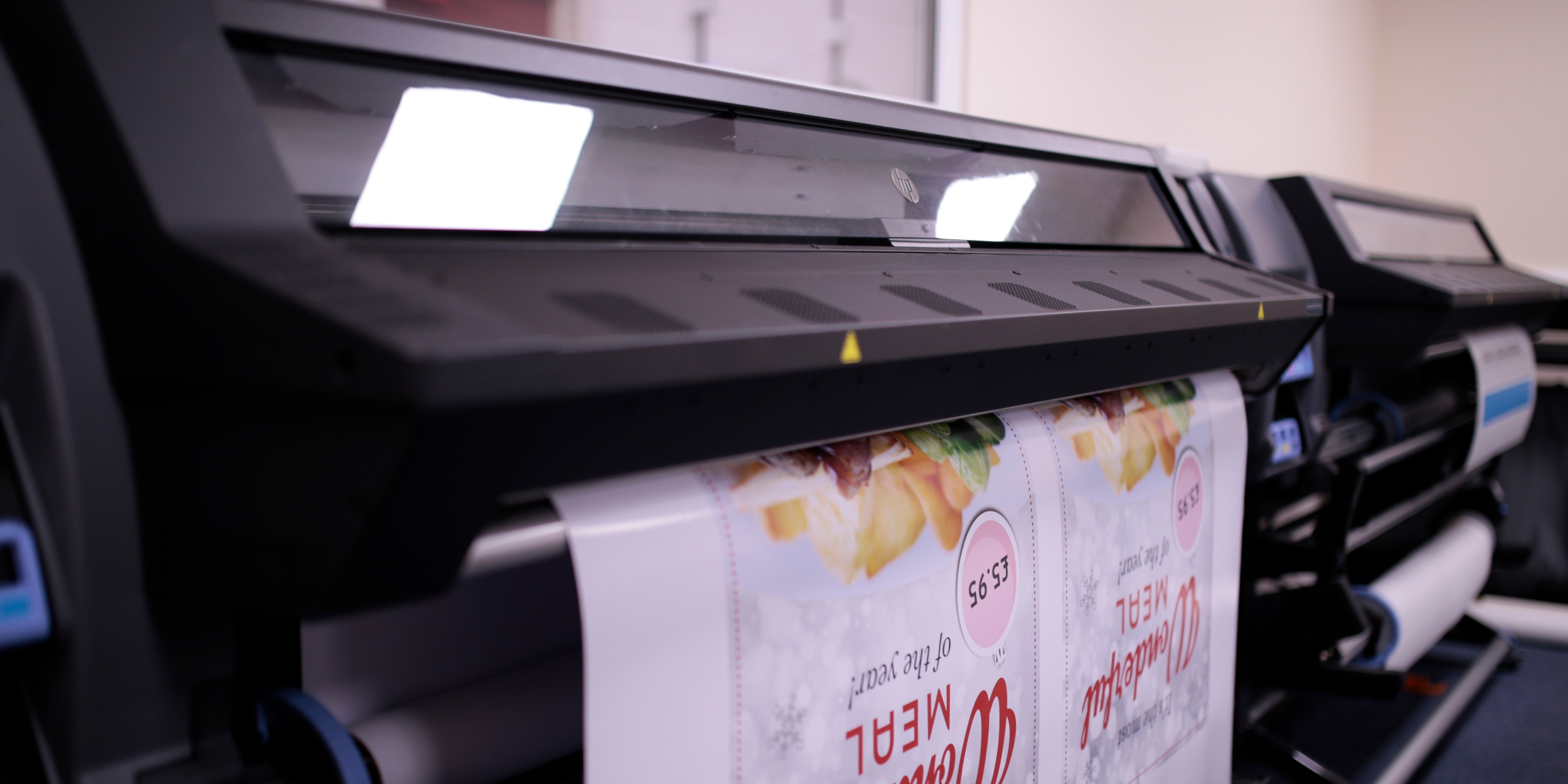 Poster being printed on a large format print machine