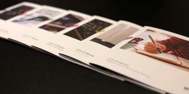 Brochures spread across the table