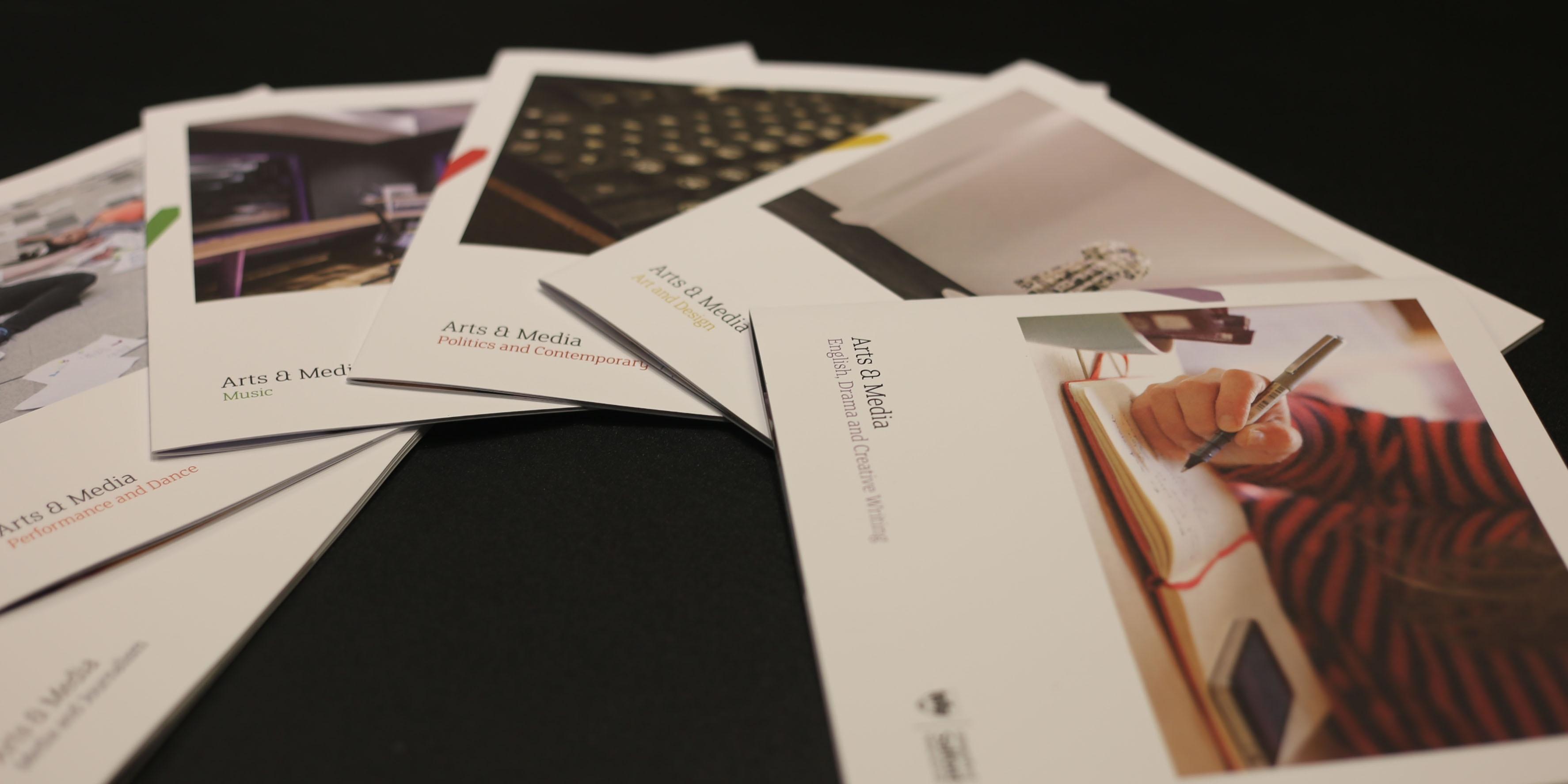 Brochures Spread On Table