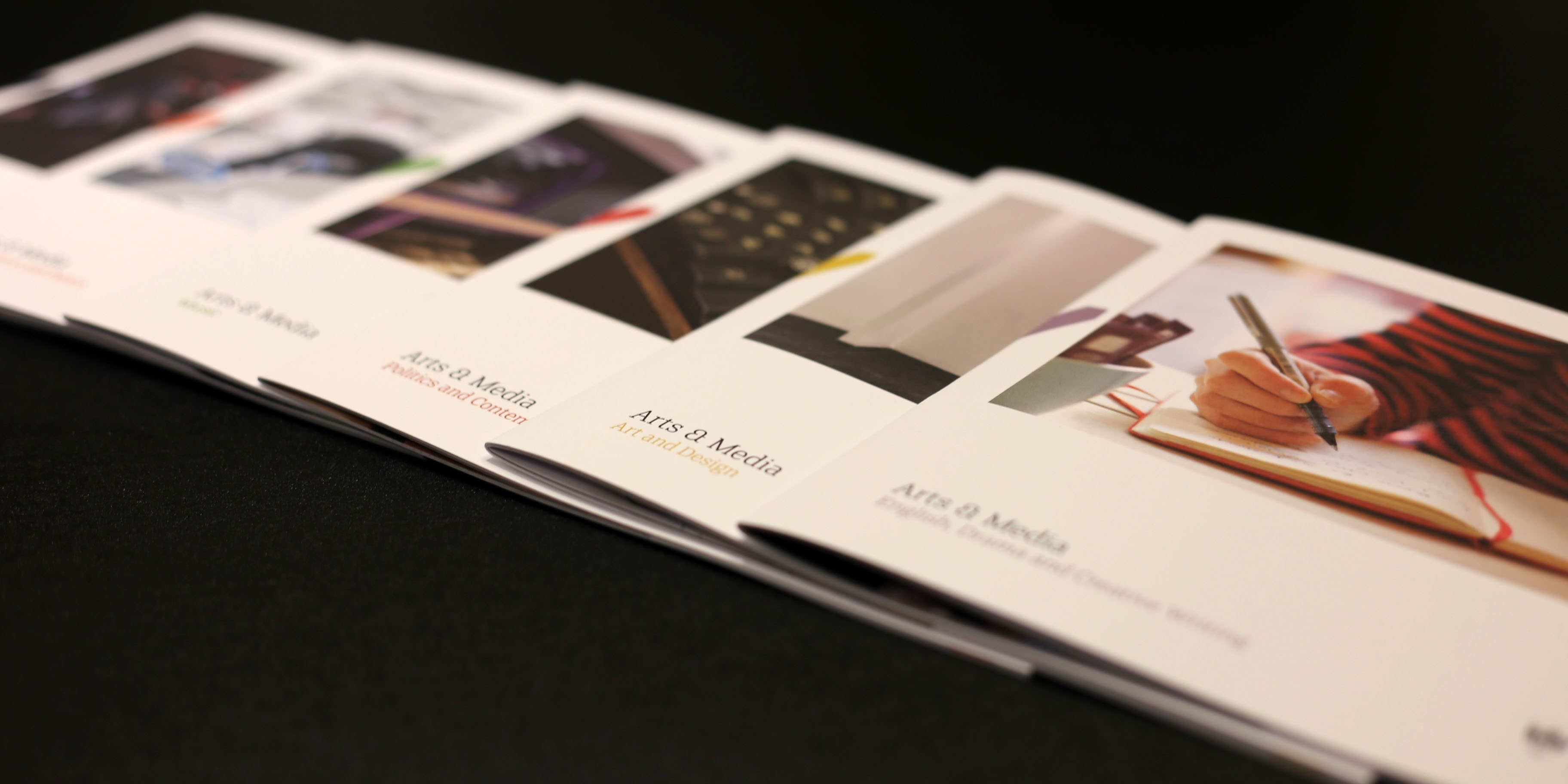 brochures on table printed on luxury printing paper