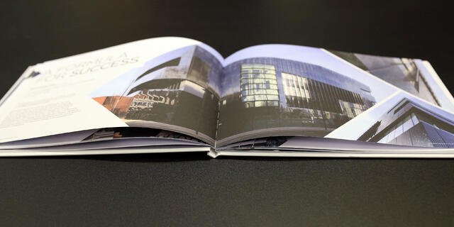 Luxury brochure opened on a table