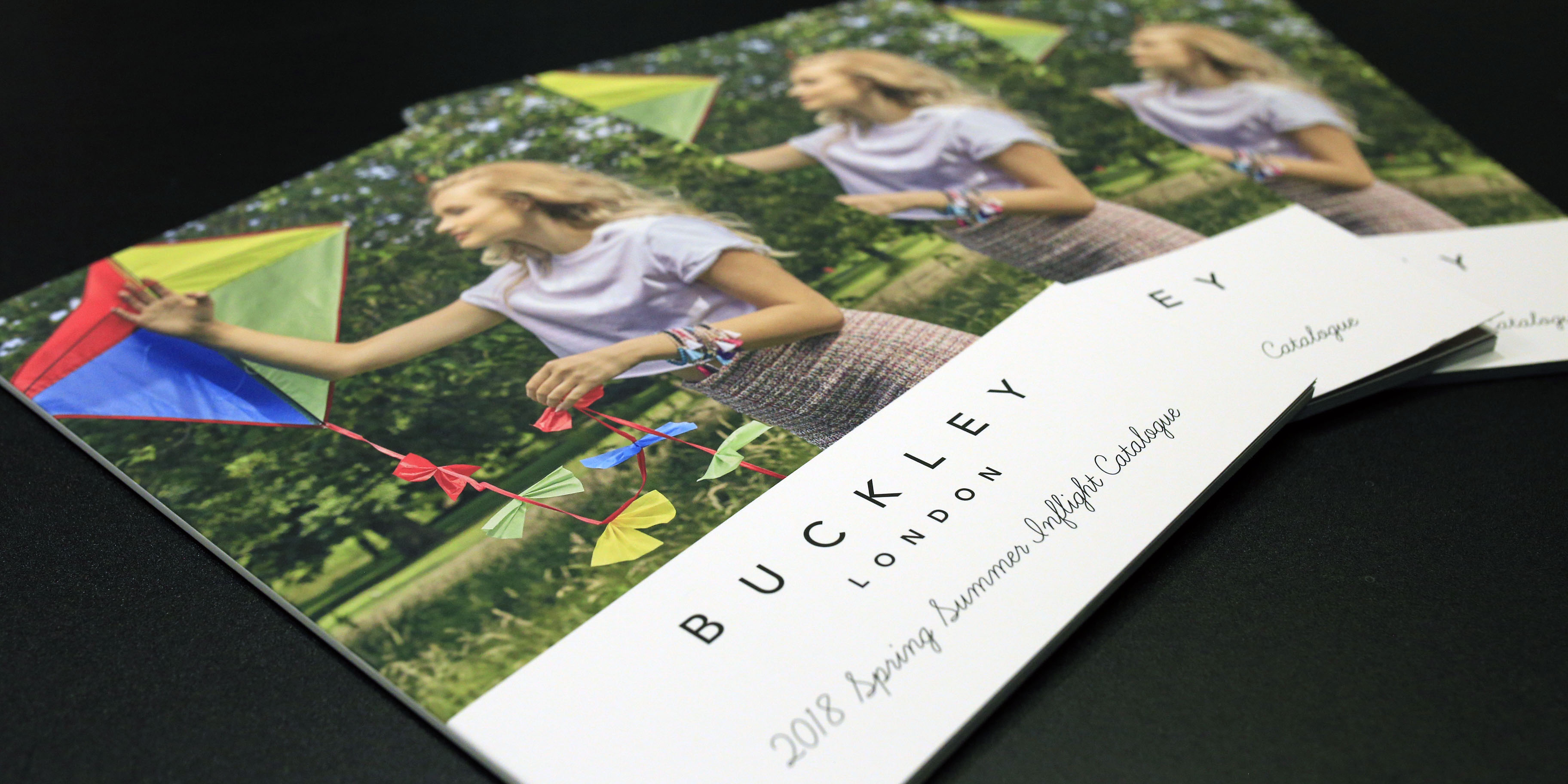 Buckley London brochures on table