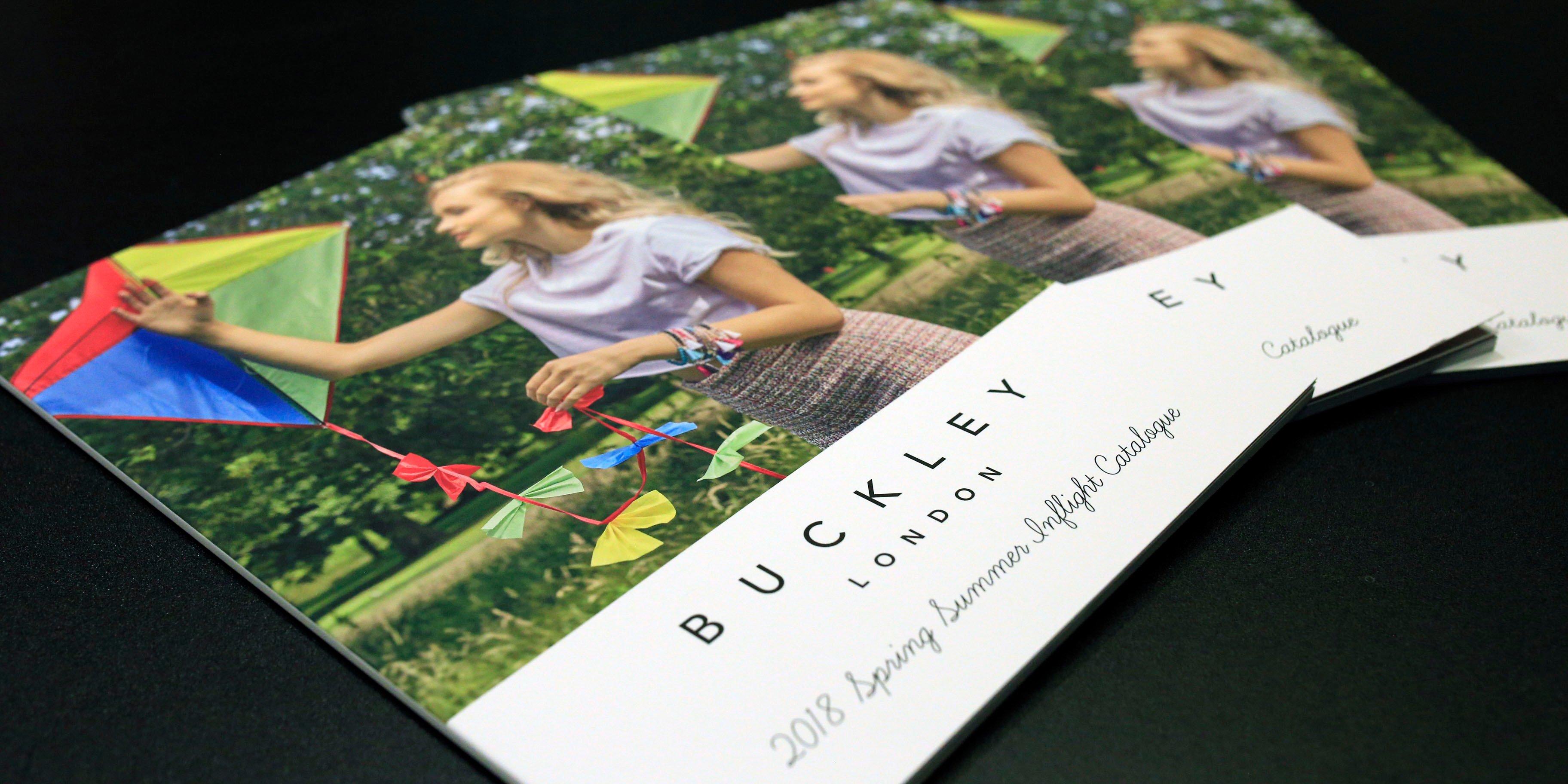 Buckley London brochures on table