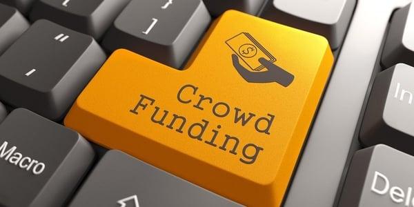 Orange Crowd Funding Button on Computer Keyboard. Internet Concept.-677888-edited