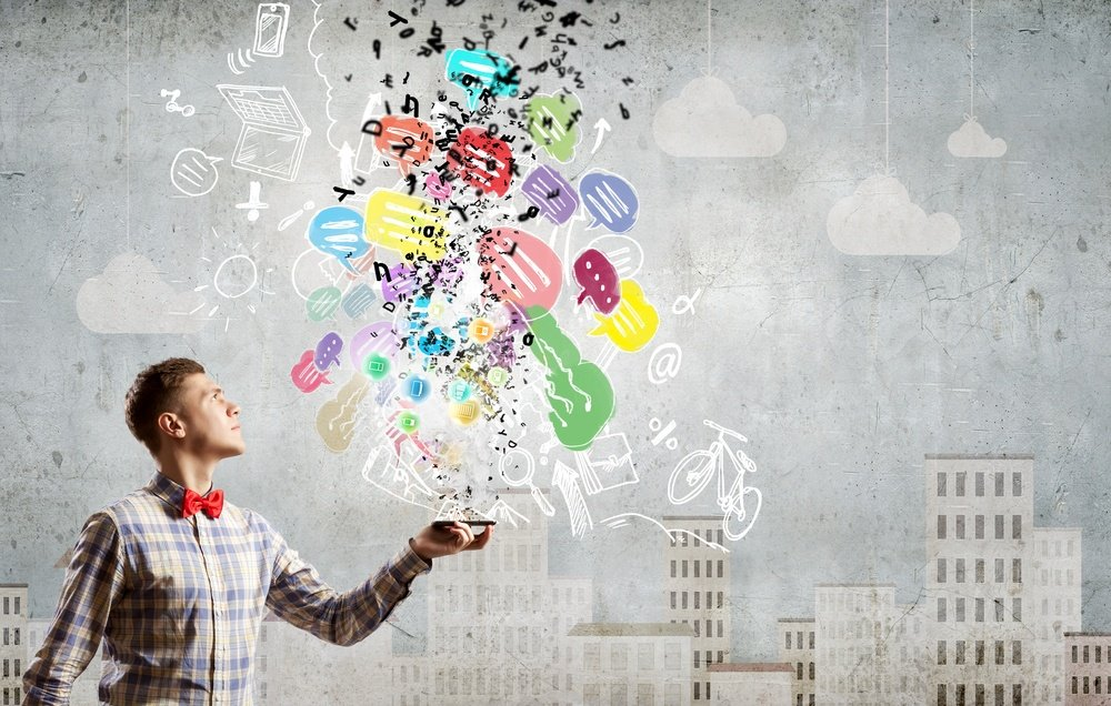 Young man with mobile phone and colorful chat icons